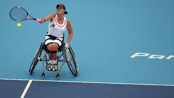 Katharina Kruger of Germany plays a shot while competing with Sabine Ellerbrock against Jordanne Whiley and Lucy Shuker of Great Britain during the women