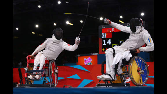 Chinese Daoliang Hu, left, on his way to winning gold against Ukrainian Anton Datsko on Tuesday during the men