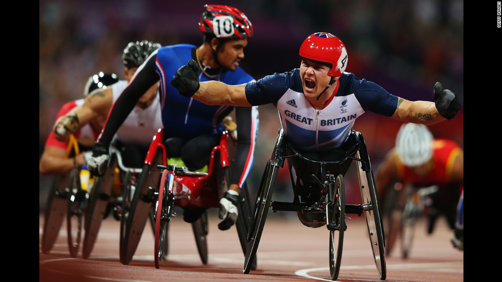 British racer David Weir celebrates winning the Men's 1500-meter T54 final on Tuesday.