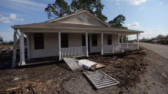 A home washed away from its foundation sits on a roadside Tuesday in Braithwaite in Plaquemines Parish.