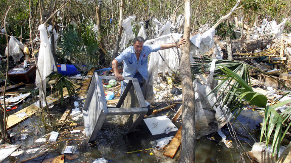 Louis Lipps tries to salvage belongings near his house on Lake Pontchartrain in LaPlace, Louisiana, on Tuesday, September 4.  Many residents returning to their homes in southern Louisiana after Hurricane Isaac will find little comfort. Authorities have blamed eight U.S. deaths on Isaac, six of them in Louisiana, after it made landfall last week as a Category 1 hurricane.