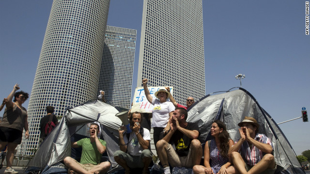 Israeli demonstrators block a main junction with tents as they protest against rising housing prices and social inequalities in Tel Aviv, July, 2011.