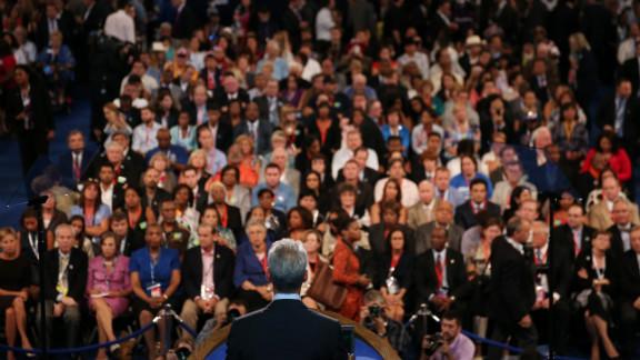 People listen to Chicago Mayor Rahm Emanuel on Tuesday.