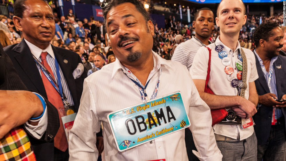 Robert Rios of the Virgin Islands wears a President Obama license plate Tuesday.