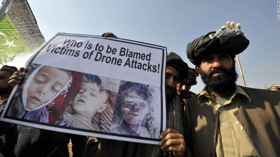 Pakistani Tribesmen Show A Placard Of Alleged Drone Strike Victims Peter Bergen Says The