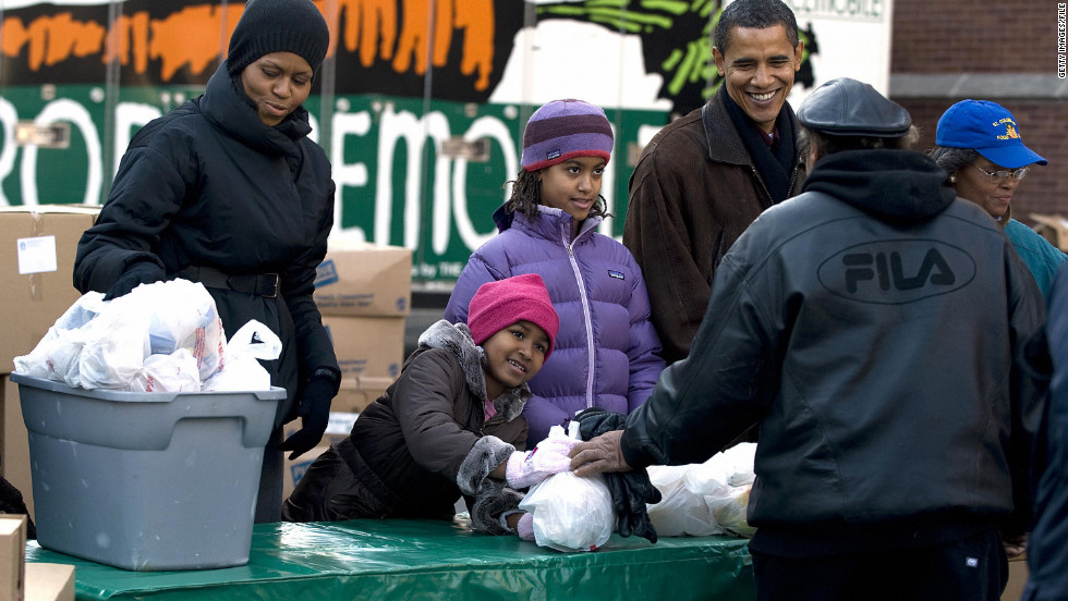 The family hands out food for Thanksgiving in their hometown of Chicago in November 2008 shortly after Barack Obama's campaign victory.