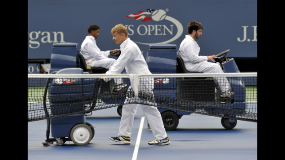 Attendants get the court ready for Wednesday's match between Bartoli and Sharapova.