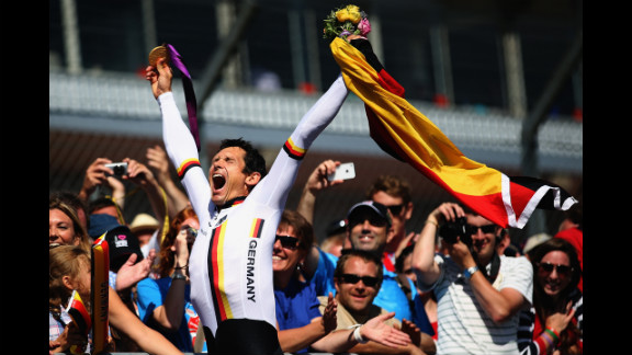 Michael Teuber of Germany celebrates winning the men