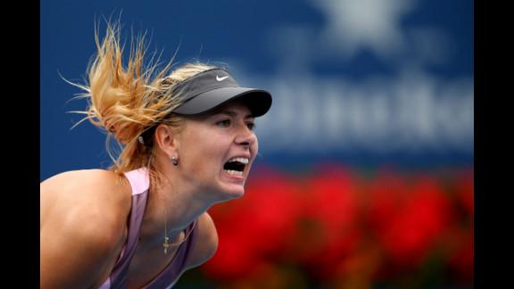 Russian Maria Sharapova serves to France's Marion Bartoli during their women's singles quarterfinal match on Wednesday.