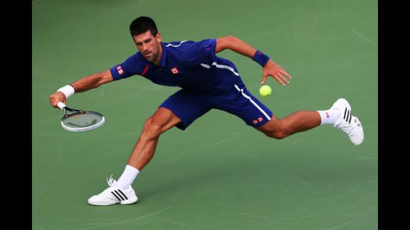 Serbia's Novak Djokovic pulls back to return a shot to Stanislas Wawrinka of Switzerland during his men's singles fourth-round match on Wednesday.