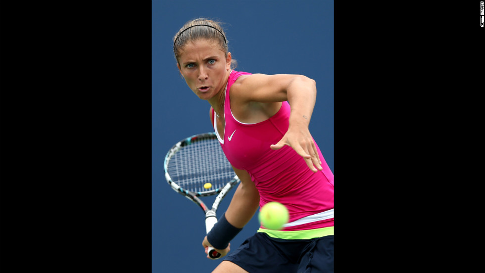 Italian Sara Errani returns a shot against countrywoman Roberta Vinci during Wednesday's women's singles quarterfinal match.