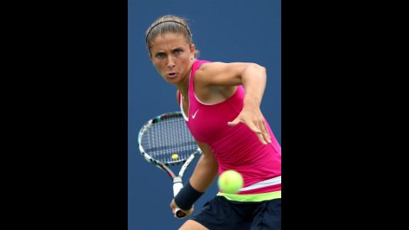 Italian Sara Errani returns a shot against countrywoman Roberta Vinci during Wednesday's women's singles quarterfinal match.