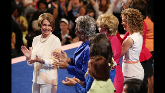 Pelosi and other female members of Congress applaud on Tuesday.