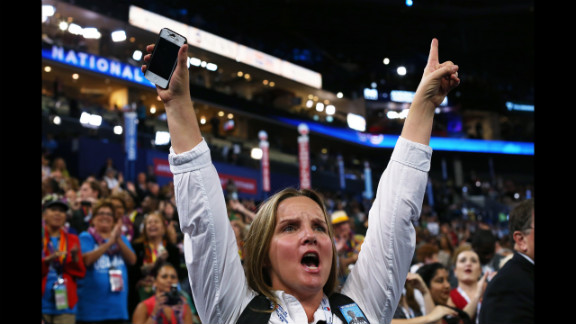 DNC delegates cheer during Tuesday