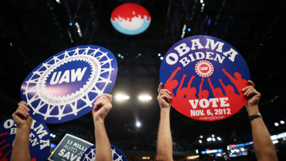 Delegates wave union signs supporting Barack Obama on Wednesday.