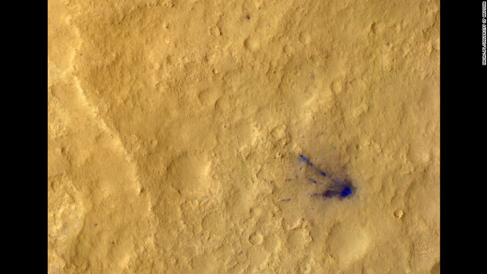 Sub-image three shows the descent stage crash site, now in color, and several distant spots (blue in enhanced color) downrange that are probably the result of distant secondary impacts that disturbed the surface dust.