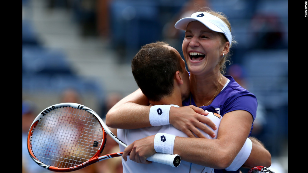 Ekaterina Makarova of Russia and Bruno Soares of Brazil celebrate after defeating Kristyna Pliskova of the Czech Republic and Marcin Matkowski of Poland to win their mixed doubles final match on Thursday.