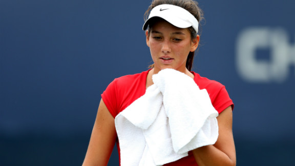 Ipek Soylu of Turkey wipes her face during a break against American Chalena Scholl during their girl's juniors singles match on Thursday.