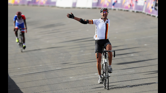 Wolfgang Sacher of Germany crosses the finish line in the men