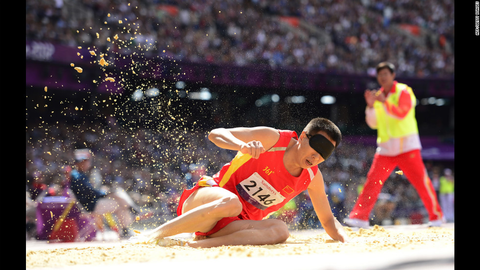 China's Li Duan competes in the men's triple jump F11 final on Thursday.