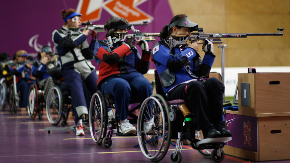Yoojeong Lee of the Republic of Korea, right, shoots during the women