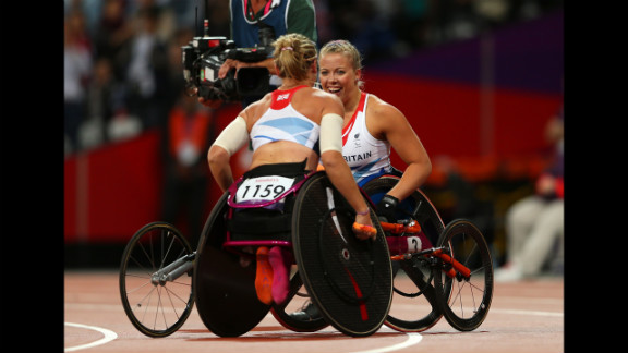 Gold medalist Hannah Cockroft of Great Britain is congratulated by Melissa Nicholls of Great Britain on Thursday.
