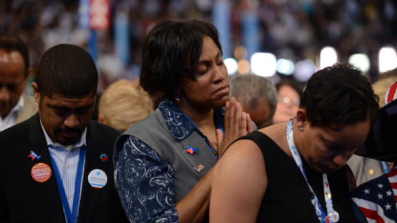 Supporters pray during an invocation on Thursday.