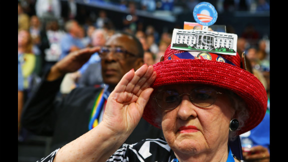A woman salutes during the DNC on Thursday.