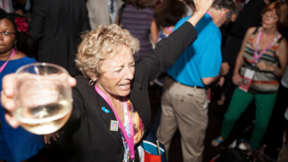 """A woman dances at the nightclub in Charlotte on Tuesday. """"This party seems like a way to drum up enthusiasm with the base,"""" Steiner says."""