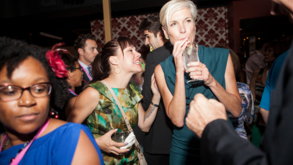 Planned Parenthood President Cecile Richards, right, sips her drink and socializes at Tuesday
