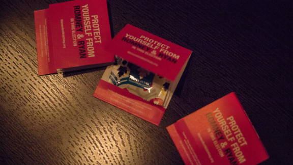 """Condoms in hot pink matchbook covers are distributed as party favors. They read: """"Protect yourself from Romney & Ryan in this election."""""""