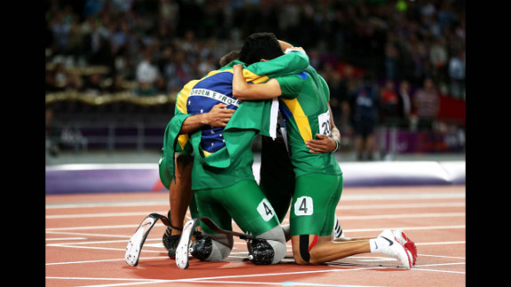Members of the Brazilian team huddle after the men