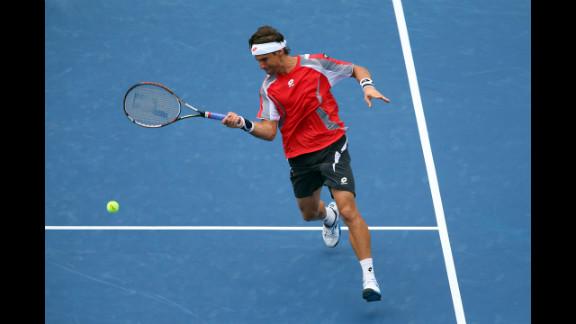 Ferrer returns a shot against Tipsarevic during their quarterfinal match.
