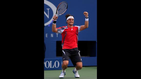 Spain's David Ferrer celebrates his men's singles quarterfinal victory over Serbia's Janko Tipsarevic on Thursday.