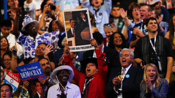 Gus Mansour holds up a poster of President Barack Obama on Thursday.
