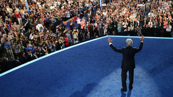 U.S. Sen. John Kerry of Massachusetts waves onstage Thursday.
