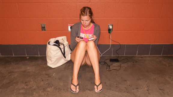 Claire Manning texts and updates her social media acocunts Thursday night from the hallways of the convention center.