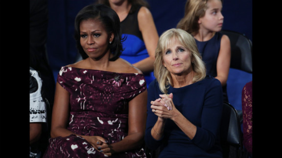 First lady Michelle Obama sits with Dr. Jill Biden on Thursday as Joe Biden accepts the vice presidential nomination.