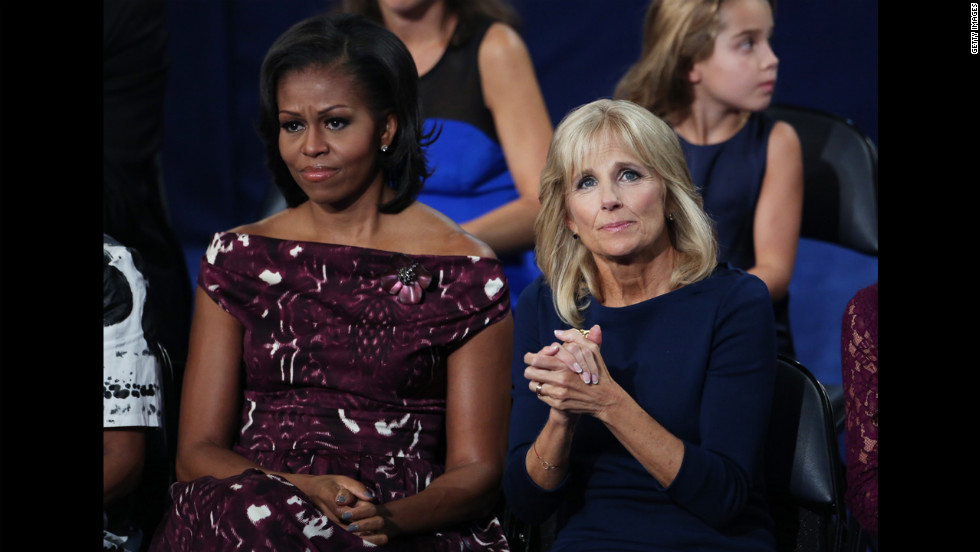 First lady Michelle Obama sits with Jill Biden as Vice President Joe Biden speaks on Thursday.