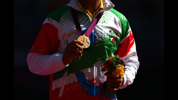 Bronze medalist Farzad Sepahvand of Iran poses Friday during the medal ceremony for the men