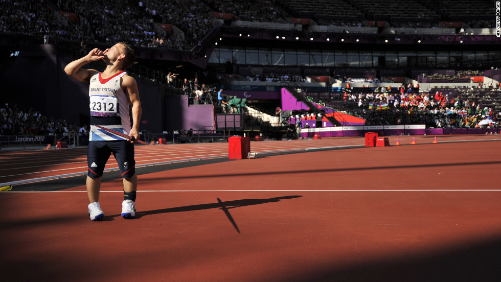 Britain's Kyron Duke asks for quiet before competing Friday in the men's javelin throw F40 final.