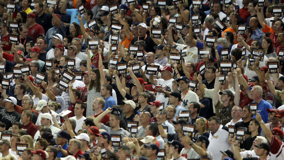 Fans hold signs for the Stand Up to Cancer campaign during the MLB All-Star Game in July 2011 in Phoenix.