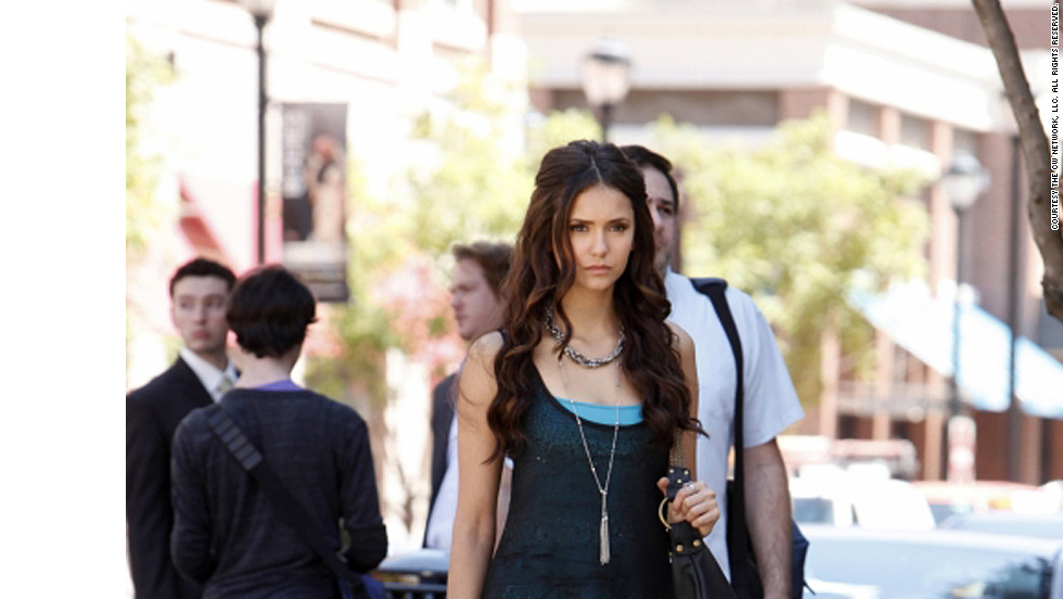 "Dobrev plays centuries-old vampire Katherine, pictured, as well as her human doppelganger Elena. Leverett makes it easy for viewers to differentiate between the characters by dressing Katherine in edgier styles. ""I like to think that Katherine saw those tan Michael Kors heels on some unsuspecting Chicago socialite and probably just compelled her to hand them over,"" the costume designer said."