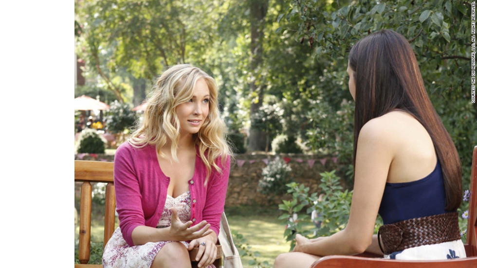 "Accola's character, Caroline, left, was recently turned into a vampire, but she's still ""a cheerleader and head of every event-planning committee at school,"" Leverett said. ""Even though she might be a blood-sucking supernatural creature, she's still a teenager at heart who wants to look cute while she's battling hybrids or the occasional vampire-hating history teacher."""