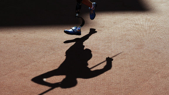 A picture shows the shadow of competitors as they compete in the men
