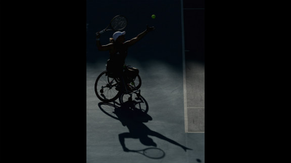 A shadow of Lucy Shuker serving with partner (out of frame) Jordanne Whiley of Great Britain to Sakhorn Khanthasit and Ratana Techamaneewat of Thailand in the women