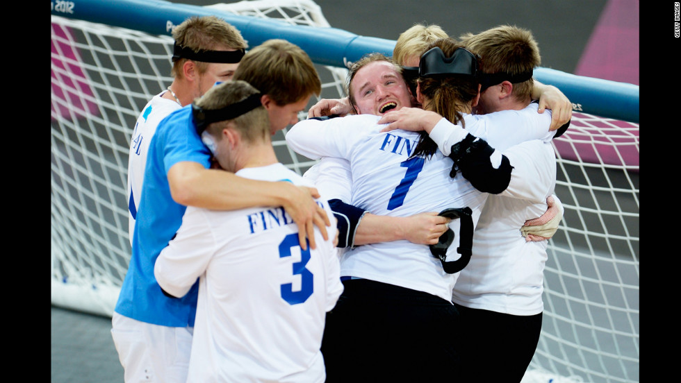 The team of Finland celebrates after winning their men's team goalball gold medal match against Brazil on Friday.