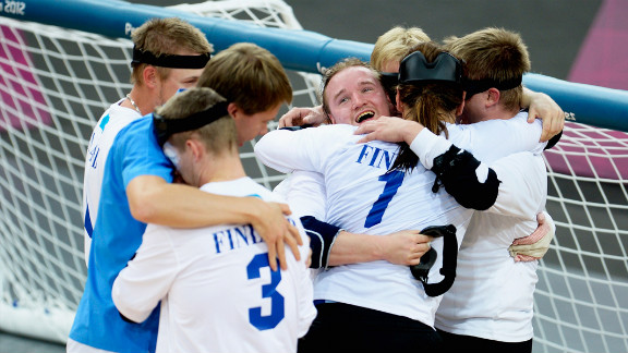 The team of Finland celebrates after winning their men