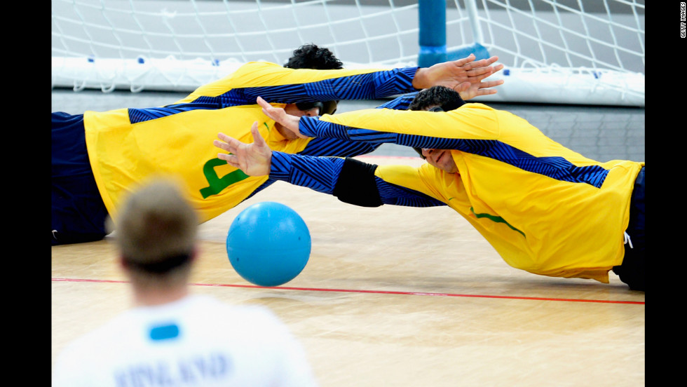 Leomon Moreno Da Silva of Brazil and teammate Jose Roberto Ferreira De Oliveira block the ball during their men's team goalball gold-medal match against Finland on Friday.