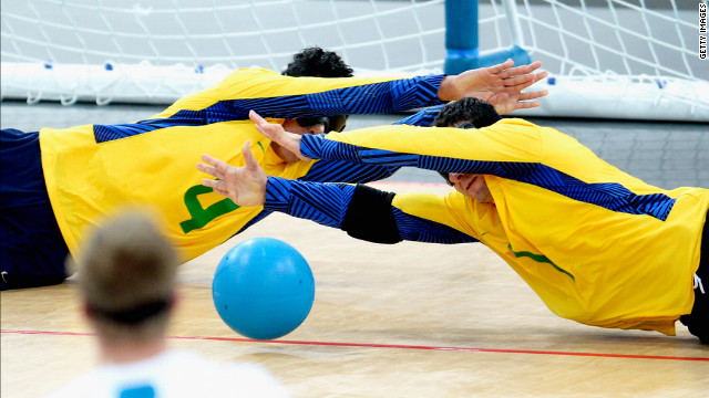Leomon Moreno Da Silva of Brazil and teammate Jose Roberto Ferreira De Oliveira block the ball during the 2012 Paralympics.